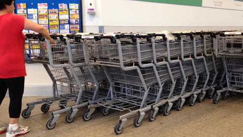Customer Returning Shopping Cart stock footage