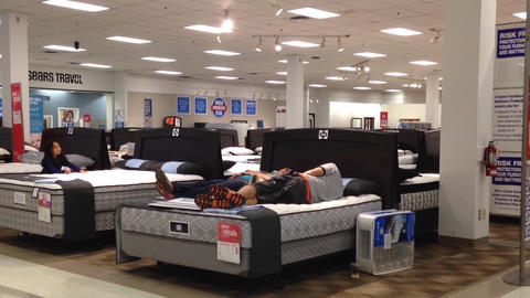 Customer shopping mattress Stock Video Footage