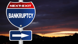 Bankruptcy road sign with flowing clouds Footage