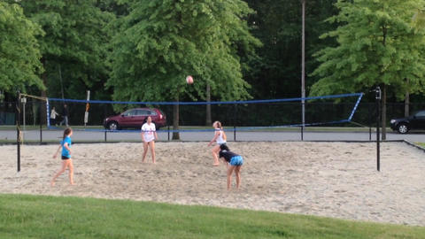 Teenagers enjoying game beach volleyball in park Stock Video Footage