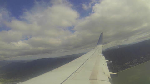 1 minute window view from the airplane flying over Footage