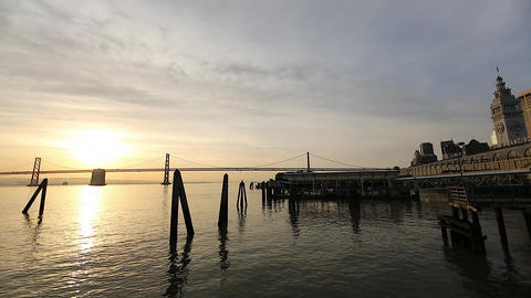 pan of bay bridge and cbd - golden sunrise Footage