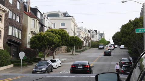 cars drive up a hill in san Francisco Footage