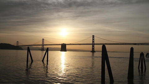 beautiful golden morning time lapse of bay bridge Stock Video Footage