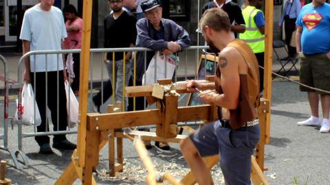 Pole lathe turning demonstration. People watching  Footage