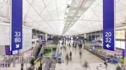 Hyperlapse video of commuters in an airport Footage