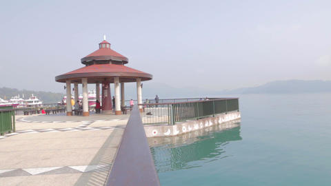 dolly shot - sun moon lake with pagoda from the it Stock Video Footage