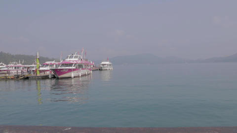 sun moon lake - people boarding boat at ita thao p Stock Video Footage