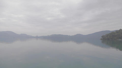 dolly shot sun moon lake on a misty morning Footage