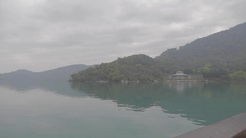 view from boat on sun moon lake in foggy weather Stock Video Footage