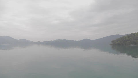 view from boat on sun moon lake in foggy weather Footage