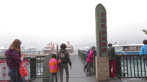 people enter shueshe pier by sun moon lake sign 2 Footage