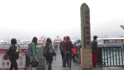 people enter shueshe pier by sun moon lake sign 2 Stock Video Footage