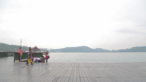 people at ita thao pier at sun moon lake with moun Footage