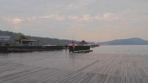 people walking at ita thao pier at sun moon lake 2 Footage