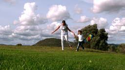 Woman and her daughter playing with kite Stock Video Footage