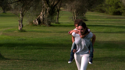 Mother running with her ​​daughter on Stock Video Footage