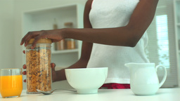 Woman pouring out cereal for breakfast Stock Video Footage