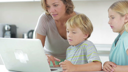 Mother and children using laptop Stock Video Footage
