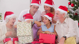Excited family exchanging gifts at christmas Footage