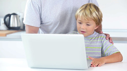 Happy father and son using laptop Footage