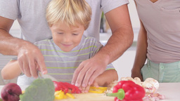 Happy family preparing vegetables Stock Video Footage