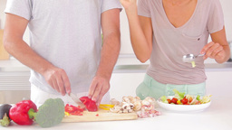 Couple preparing a salad Footage