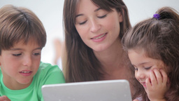 Mother and her children using tablet pc together Footage