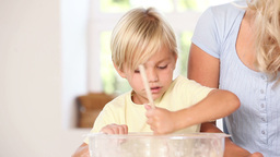 Mother and her two children preparing dough Stock Video Footage