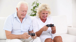Old couple playing video games Stock Video Footage