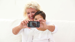 Granny taking picture with phone Footage