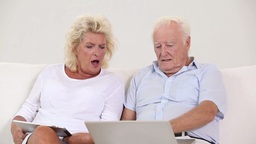 Old couple using new technology Stock Video Footage