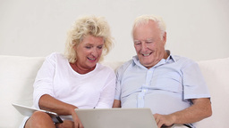 Old couple using new technology Footage