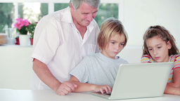 Child learning to use laptop with grandfather Stock Video Footage