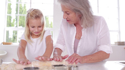 Grandmother and granddaughter using a rolling pin Footage