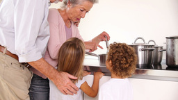 Children cooking with grandparents Stock Video Footage