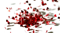 Lots of heart confetti falling on the floor Stock Video Footage