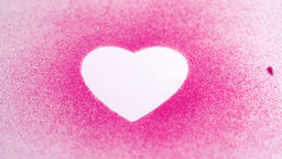 Little pink confetti falling on a white heart draw Stock Video Footage