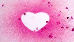Little pink confetti falling on a white heart draw Footage