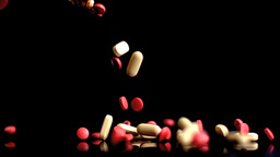 Someone pouring out jar of tablets Stock Video Footage