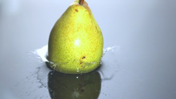 Pear falling in water Stock Video Footage