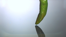 Jalapeno falling in water Stock Video Footage
