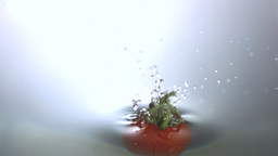 Tomato falling in water Footage