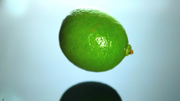 Lime falling in water close up Stock Video Footage