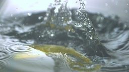 Banana dropping in water Stock Video Footage