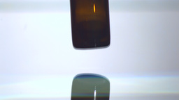 Bottle of medicine falling in water Stock Video Footage
