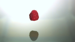 Raspberry falling into water Stock Video Footage
