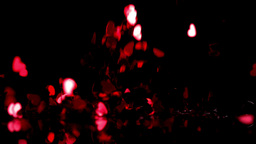 Red heart confetti falling down on black background Stock Video Footage