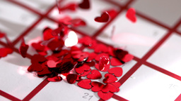 Heart confetti scattering on calendar Footage
