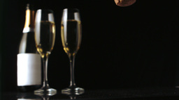 Champagne cork falling in front of two glass flute Stock Video Footage